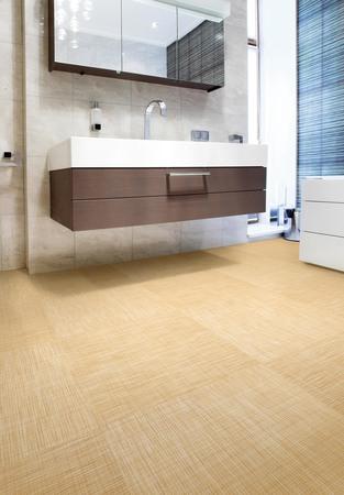 水廻りで使用可能!クッション性のある平織りの床材を発売